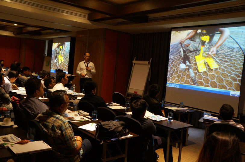 A member of the Platipus team giving a presentation to a room full of engineers