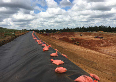 Perdido Landfill - Escambia Cty, FL - Membrane liner with sandbags on stormwater slope