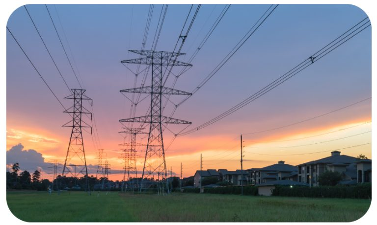 Sunset over power lines in residential area